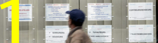 A passer by walks past the window of an temporary employment agency in Paris, Monday Sept. 29, 2008. The month of August has seen another 30,000 to 40,000 job seekers as French economy shrunk by 0.3 percent in the second quarter of 2008.(AP Photo/Remy de la Mauviniere)