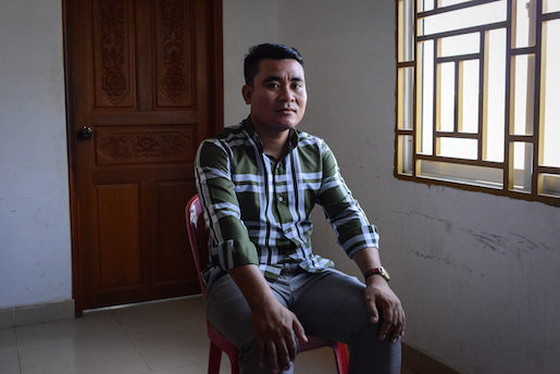 Thorn Veasna poses for a portrait at the offices of the Coalition of Cambodian Apparel Workers' Democratic Union in Phnom Penh on March 31, 2017. Veasna is 33 and works at the Roosing factory.